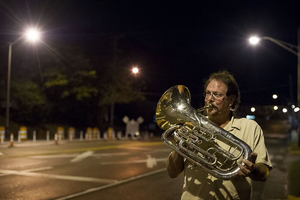 Steve Boyce, owner of Rush's Music plays the euphonium in celebration of the opening of Henley Bridge on Thursday, October 17, 2013. (SAUL YOUNG/NEWS SENTINEL)