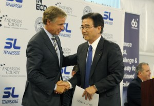 Gov. Bill Haslam shakes hands with Y.K. Woo, president of South Korean auto parts maker SL America after an announcement of expansion of its Anderson County plant. TVA contributed a hidden amount  of incentives to the deal.